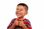 A 6 year old boy giving thumbs up and making a silly face, isolated on white background with copy space