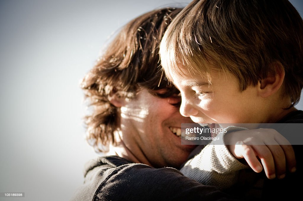 Kid and dad with sun rays : Stock Photo