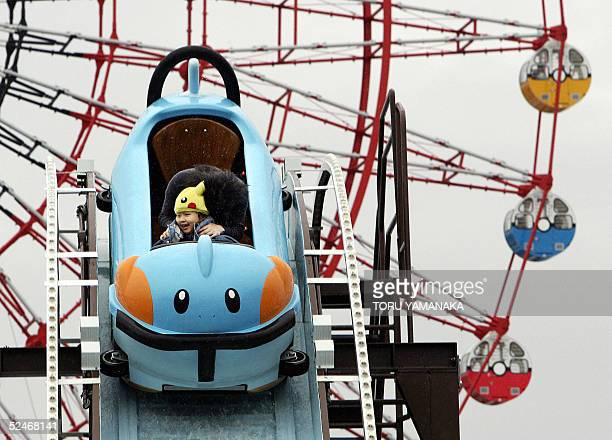 A kid and his mother enjoy a roller coaster of cartoon charactor Mudkip of Pocket Monster before a Ferris wheel at the 'Pokemon The Park 2005' near...