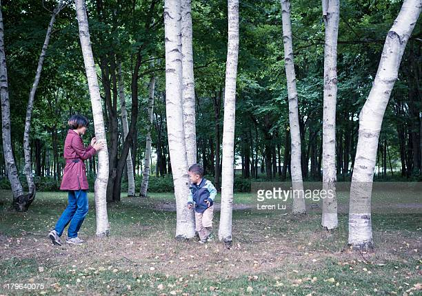 Kid and mother playing hide-and-seek game.