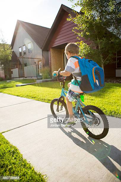 Kid biking to school.