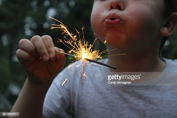 Kid Blowing on Sparkler