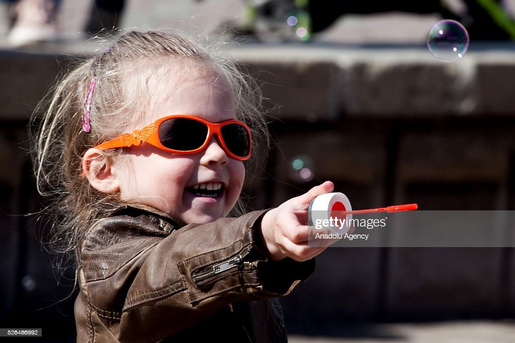 Kid blows soap bubbles during the Dreamflash soap bubble festival at the Pervomaisky Square in Novosibirsk, Russia, on April 30, 2016.