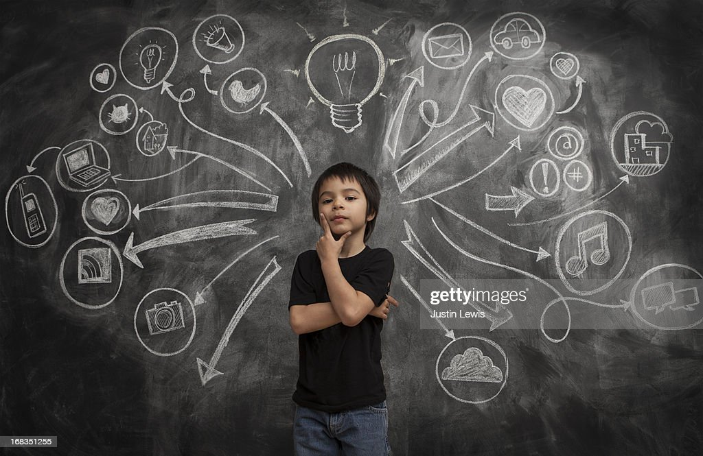 Kid boy stands with social media icon chalkboard : Stock Photo