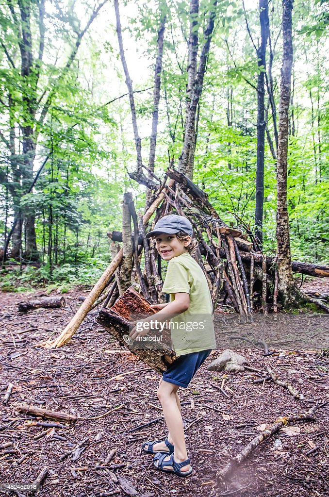 Kid building a shack in forest