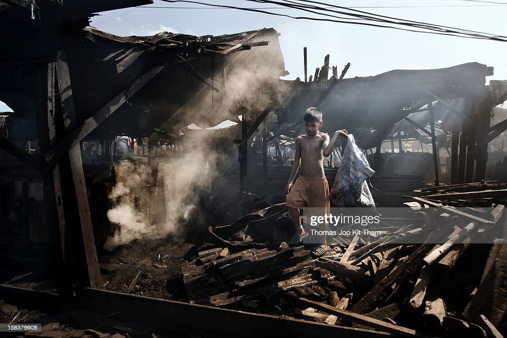 kid, child, boy, scavenger, charcoal, Ulingan, New Smokey Mountain, Tondo, Manila, Philippines, dust, smoke, child labor, work, morning, poverty