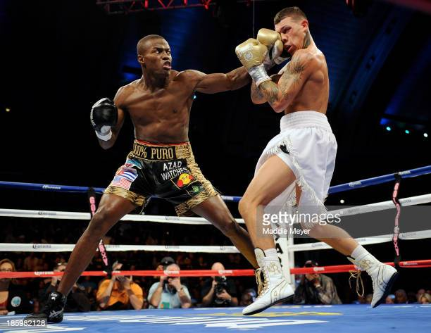 'Kid Chocolate' Peter Quillin punches Gabriel Rosado during their middleweight fight in Boardwalk Hall Arena on October 26 2013 in Atlantic City New...