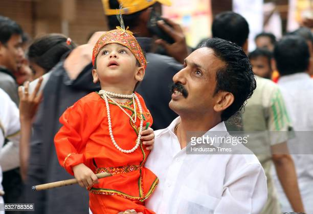 A kid dressed as Lord Krishna during Dahi Handi celebration at Dadar on August 15 2017 in Mumbai India The childgod Krishna and his friends used to...