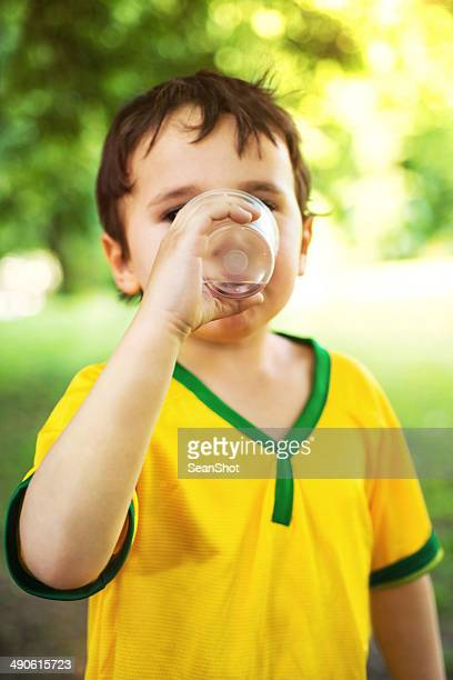 kid drinking a Glass of water