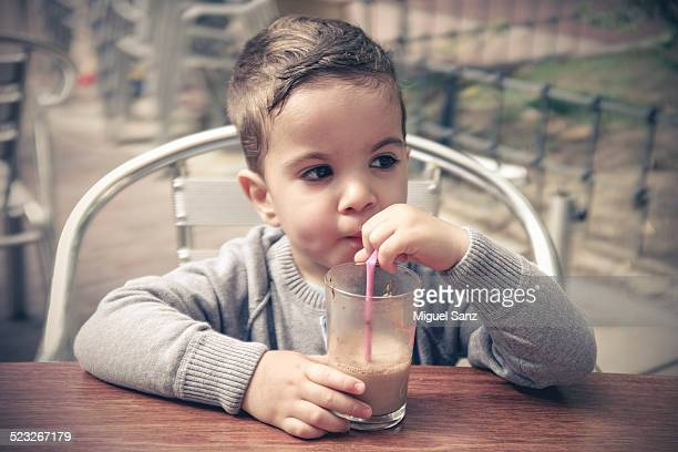 Kid drinking chocolate milk
