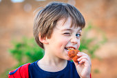 Kid eating and winking