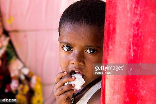 A kid eating coconut which he got from the temple as a sacrament of Goddess on the last day of Hindu festival Navratri Navratri is one of the holiest...