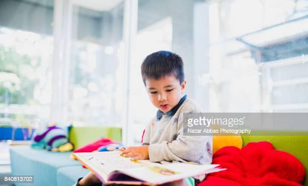 Kid enjoying picture book.