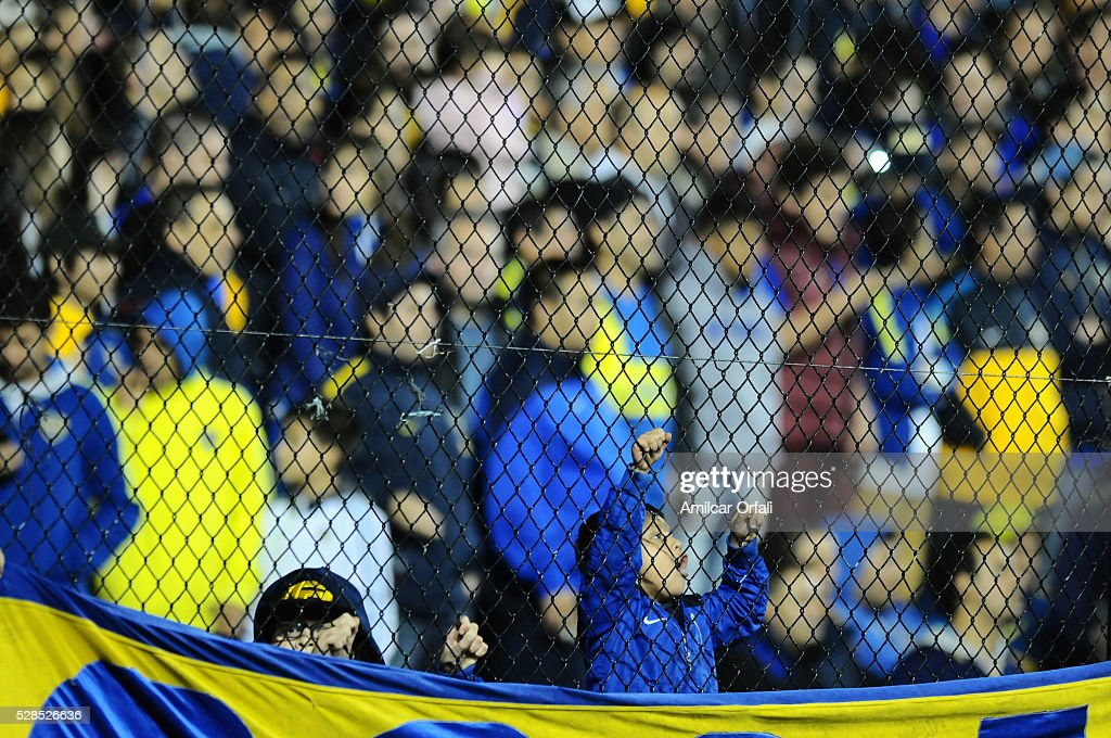 A kid fan of Boca Juniors cheers for his team during a second leg match between Boca Juniors and Cerro Porteno as part of round of sixteen of Copa Bridgestone Libertadores 2016 at Alberto J Armando Stadium on May 05, 2016 in Buenos Aires, Argentina.