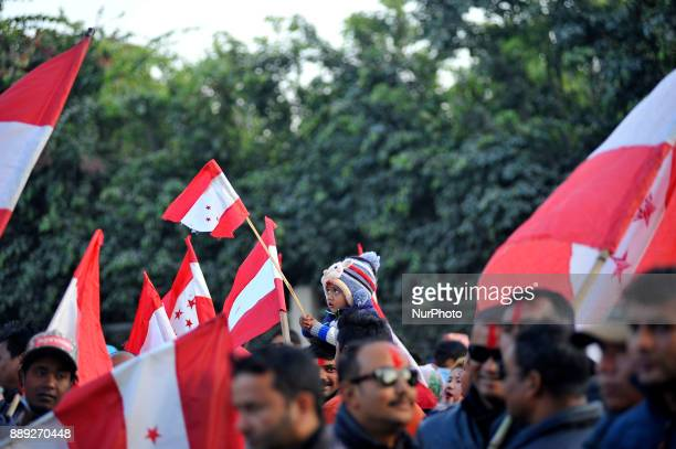 A Kid holding Nepali Congress banner as supporters take part in a victory rally of Gagan Thapa at City Hall Kathmandu Nepal on Saturday December 09...