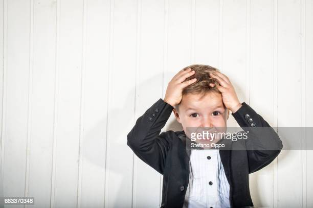 Kid in suit and bow tie