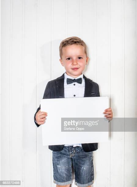 Kid in suit and bow tie with blank sign