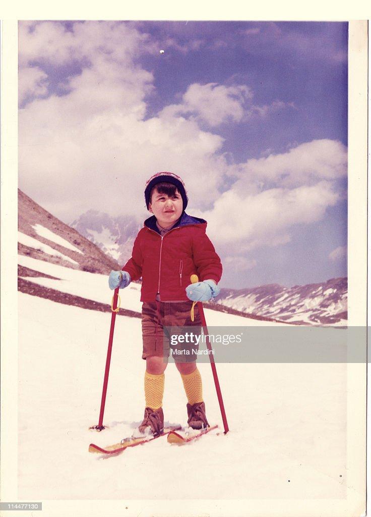 Kid in the snow -Italy 60's : Stock Photo