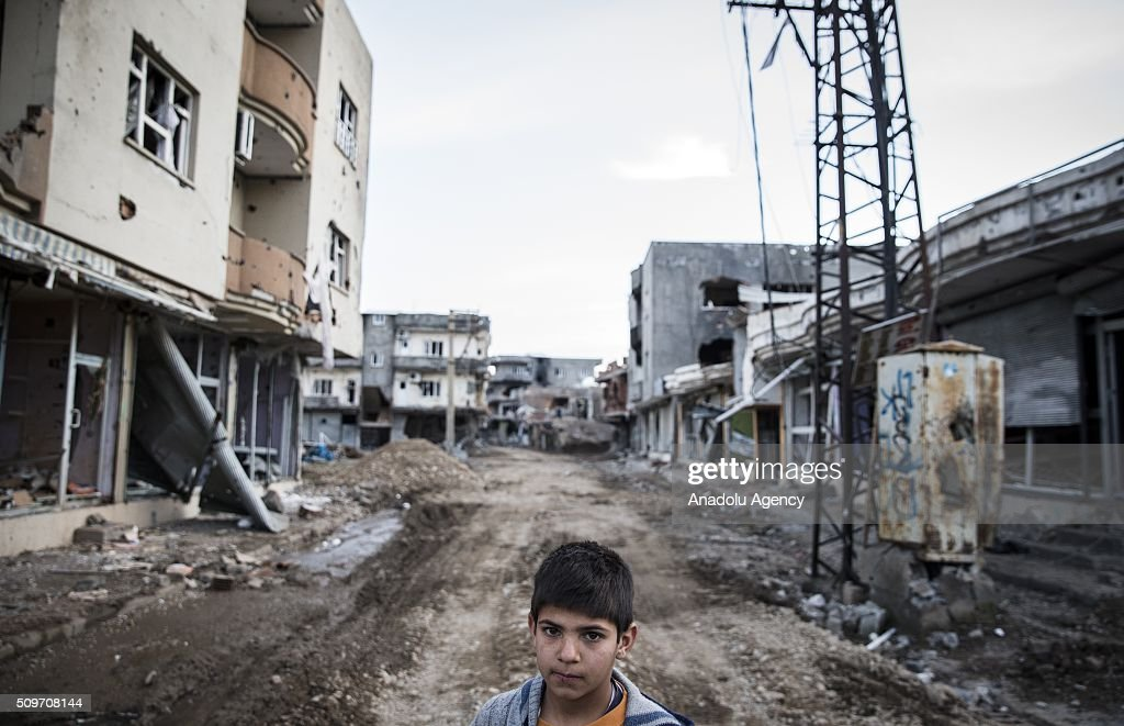 A kid is seen in the middle of a street as Turkish security forces patrol around after counter-terror operation in Cizre, the southeastern Turkish town that has seen fighting rage between security forces and PKK terrorists finished, on February 12, 2016.