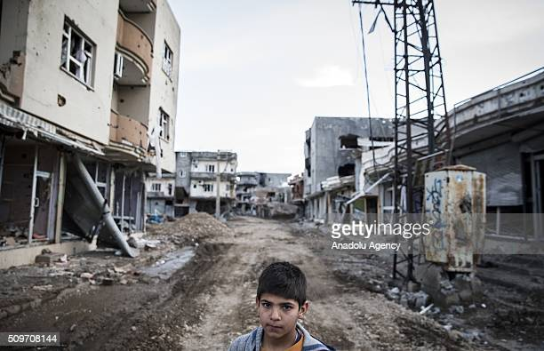 A kid is seen in the middle of a street as Turkish security forces patrol around after counterterror operation in Cizre the southeastern Turkish town...