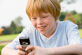 Kid looking at a camera phone