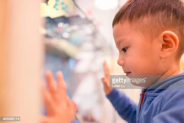 Kid looking at toys in a toy store