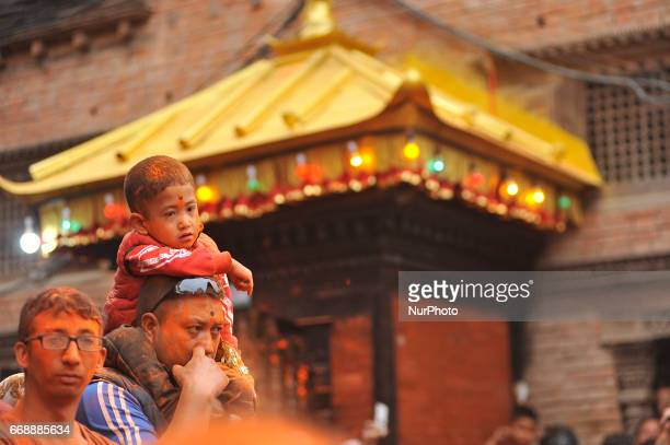 A Kid observing festival during the celebration of quotSindoor Jatraquot vermillion powder festival as Nepalese New Year day celebration at Thimi...