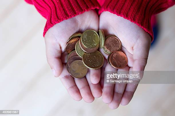 Kid offering money in his hands