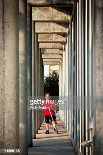 Kid on scooter : Stock Photo