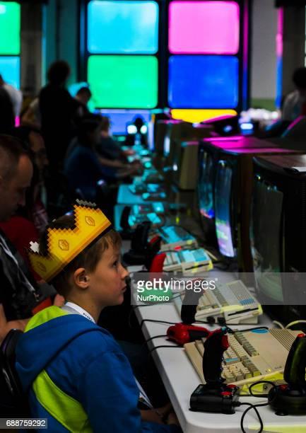Kid play oldschool video games on Pixel Heaven fair in Warsaw 26 May Poland