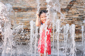 Kid playing in fountain
