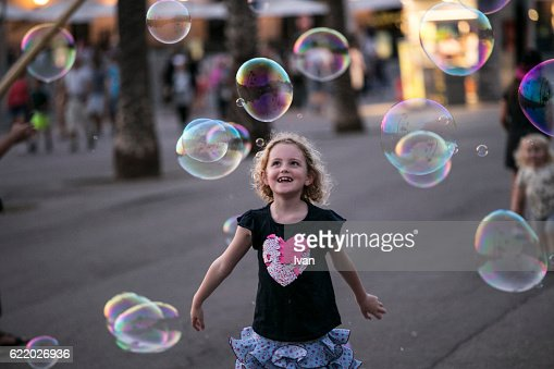 Kid Playing with Giant Soap Bubbles