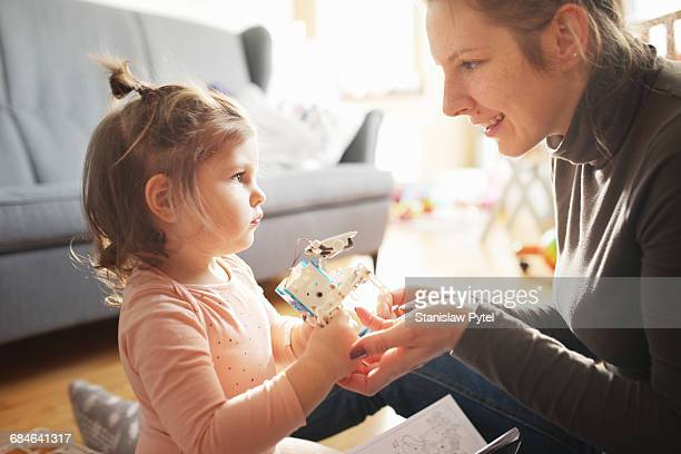Kid playing with mum with robot
