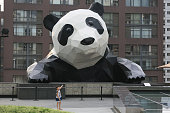 A kid points at the 15metertall panda sculpture on the Chengdu IFS building on July 25 2016 in Chengdu Sichuan Province of China The 15metertall...