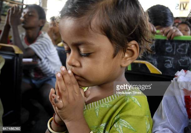 Kid praying before lunch inside a bus which is converted in to a school by Vision Rescue a social organisation for street children in Dadar Mumbai on...