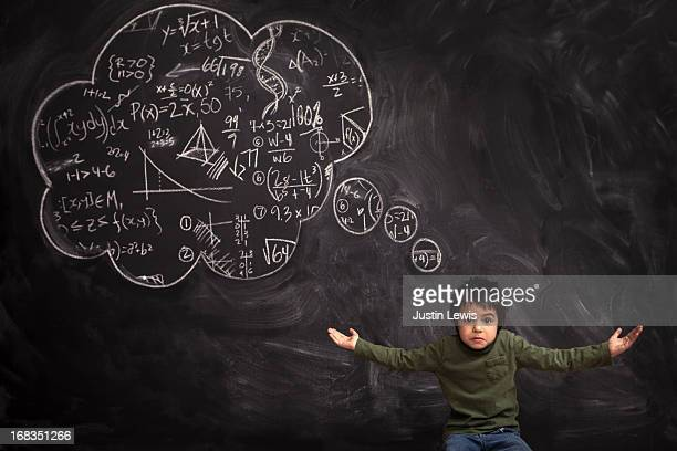 Kid puts his arms up with a math though bubble