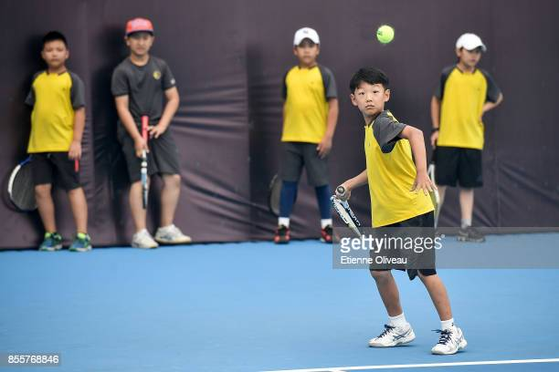 A kid returns a shot against Johanna Konta of Great Britain during the event 'Tennis into Campus' during day 1 of the 2017 China Open at the China...