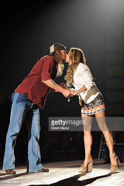 Kid Rock and Sheryl Crow perform on stage at the 2011 CMT Music Awards at the Bridgestone Arena on June 8 2011 in Nashville Tennessee