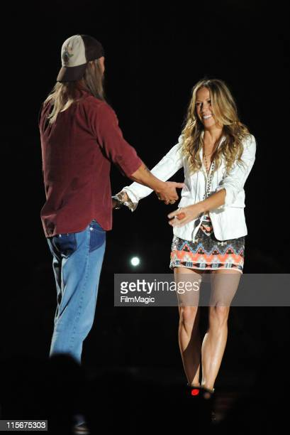 Kid Rock and Sheryl Crow perform on stage during the 2011 CMT Music Awards at the Bridgestone Arena on June 8 2011 in Nashville Tennessee