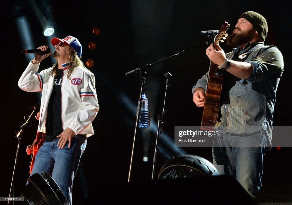 <a gi-track='captionPersonalityLinkClicked' href=/galleries/search?phrase=Kid+Rock&family=editorial&specificpeople=171123 ng-click='$event.stopPropagation()'>Kid Rock</a> joins Zac Brown on stage to perform 'Were an American Band' during the 2013 CMA Music Festival on June 6, 2013 in Nashville, Tennessee.
