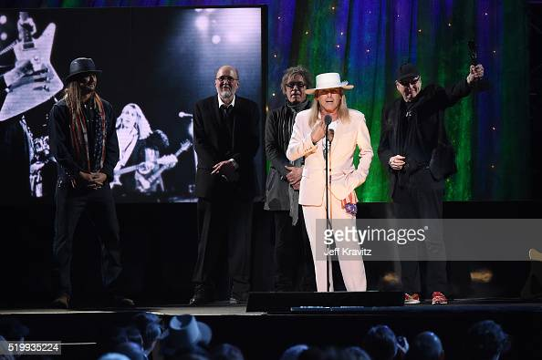 Kid Rock looks on as inductees Bun E Carlos Tom Petersson Robin Zander and Rick Nielsen of Cheap Trick speak on stage at the 31st Annual Rock And...