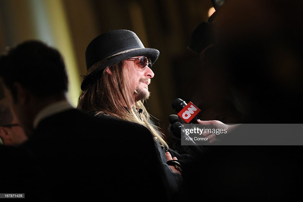 <a gi-track='captionPersonalityLinkClicked' href=/galleries/search?phrase=Kid+Rock&family=editorial&specificpeople=171123 ng-click='$event.stopPropagation()'>Kid Rock</a> poses for photographers during the 35th Kennedy Center Honors at the Kennedy Center Hall of States on December 2, 2012 in Washington, DC.