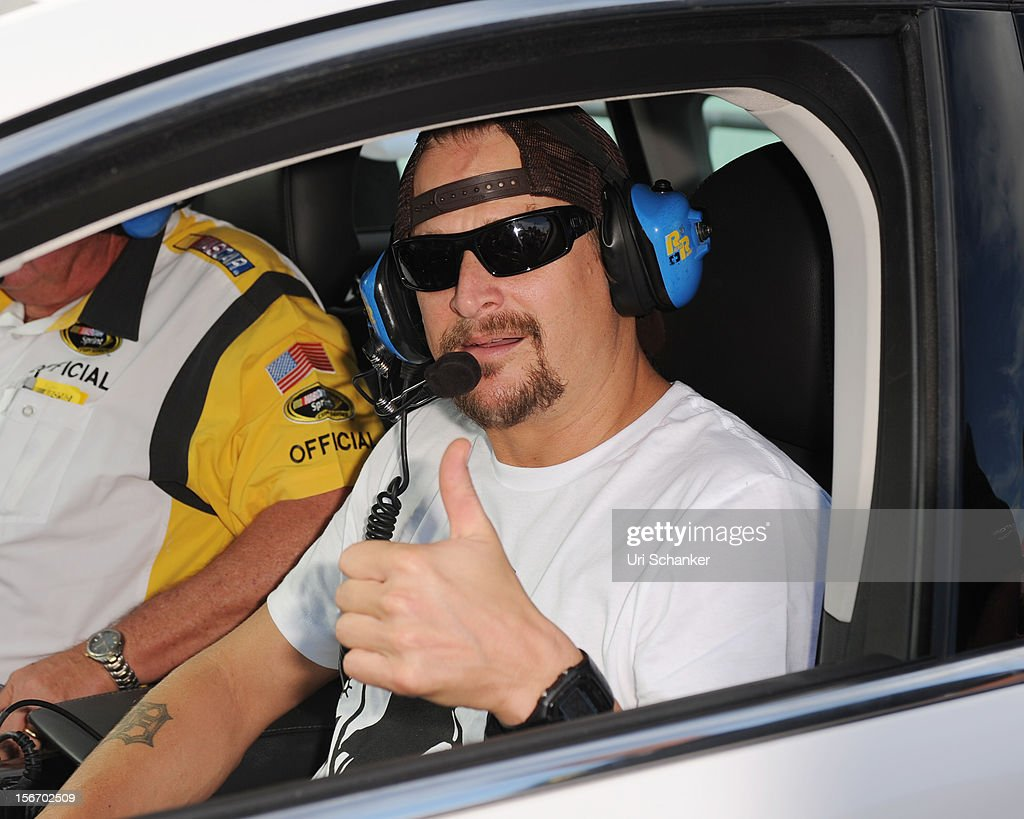 <a gi-track='captionPersonalityLinkClicked' href=/galleries/search?phrase=Kid+Rock&family=editorial&specificpeople=171123 ng-click='$event.stopPropagation()'>Kid Rock</a> poses with the pace car at the NASCAR Sprint Cup Series Ford Ecoboost 400 at Homestead-Miami Speedway on November 18, 2012 in Homestead, Florida.