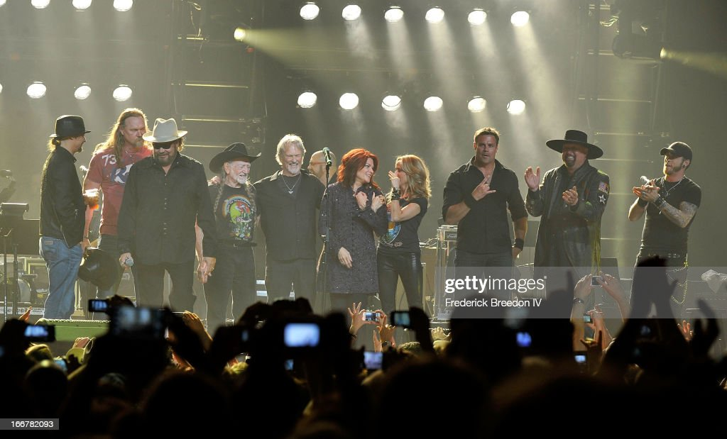 Kid Rock, Trace Adkins, Hank Williams Jr., Willie Nelson, Kris Kristofferson, Rosanne Cash, Sheryl Crow, Montgomery Gentry and Brantley Gilbert perform during Keith Urban's Fourth annual We're All For The Hall benefit concert at Bridgestone Arena on April 16, 2013 in Nashville, Tennessee.