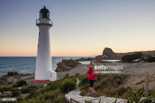 Kid running down the Castlepoint lighthouse walkwa