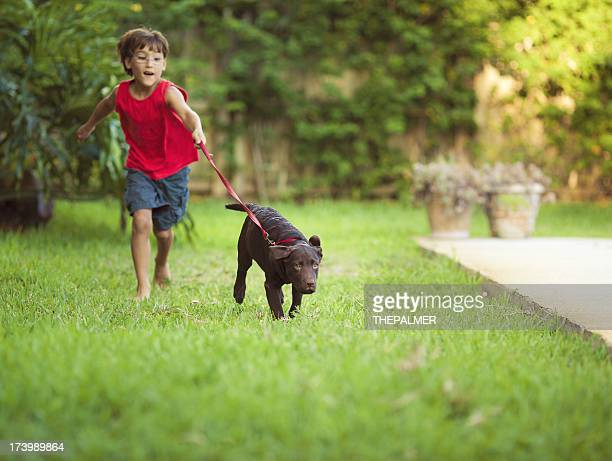kid running with his dog