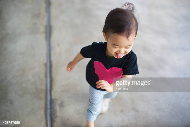 A kid runs on concrete flour