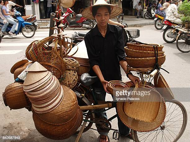 Kid selling hats and craft in Hanoi street