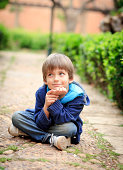 Kid sitting on the alley