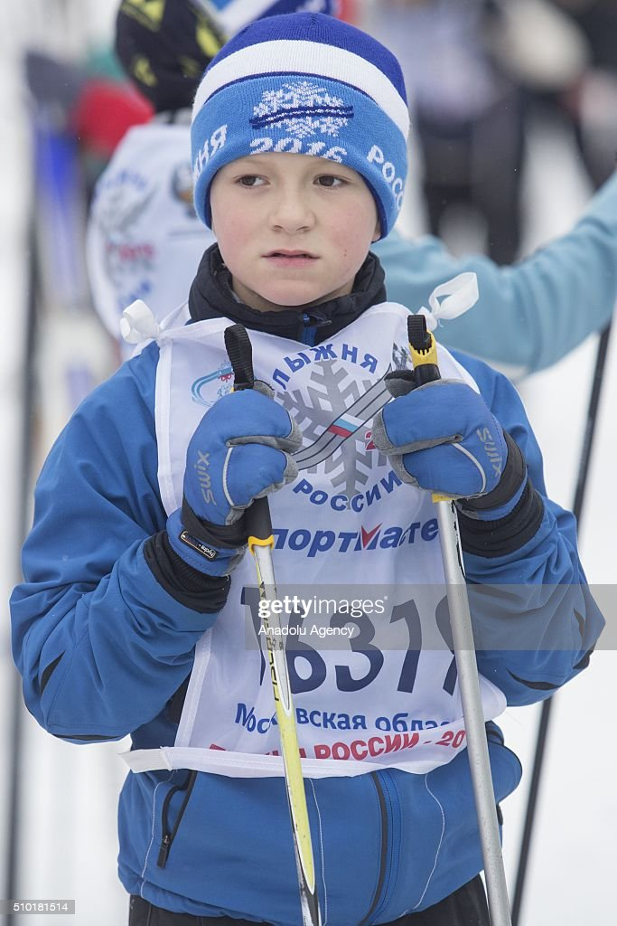 A kid skier waits before start all-Russian mass ski race 'Ski Track of Russia' at the basis of the Olympic training center 'Planernaya' in Khimki, Russia on February 14, 2016.